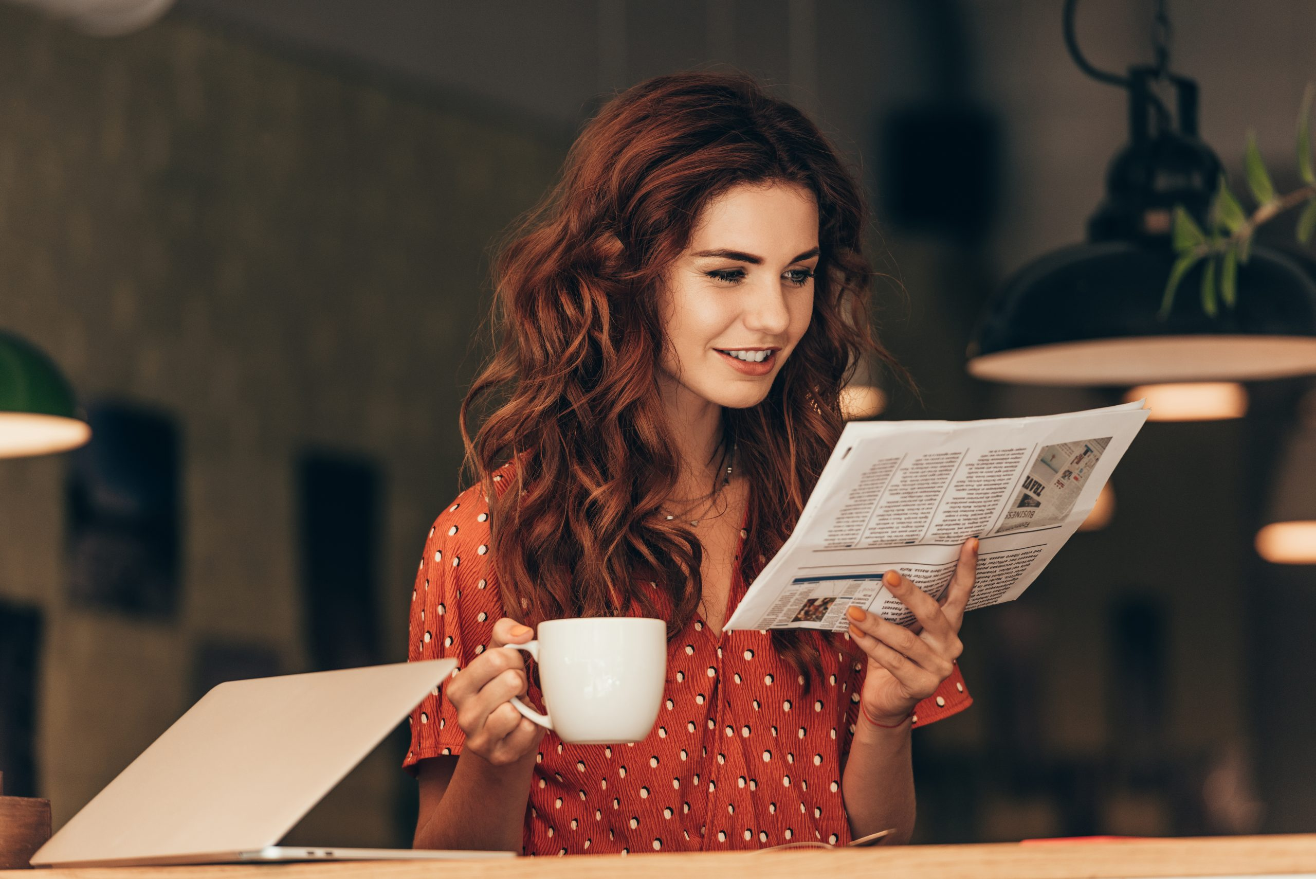 Women reading paper